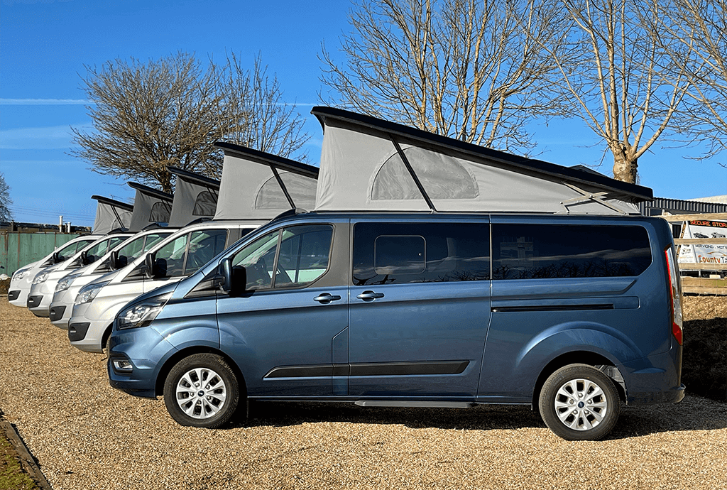 campervans lined up outside