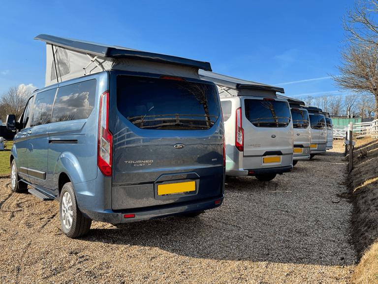 campervans line up from behind wide